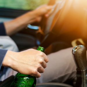 drinking driving man holding alcohol bottle