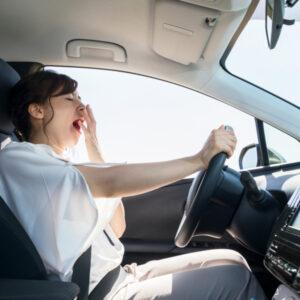female driver falling asleep
