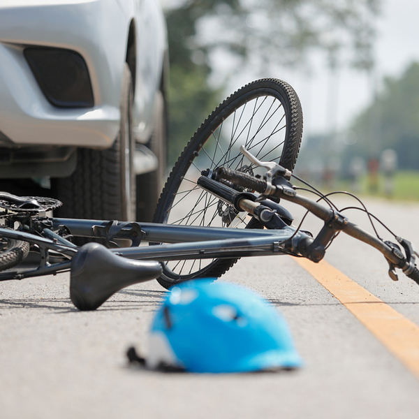 car accident and bicycle on road