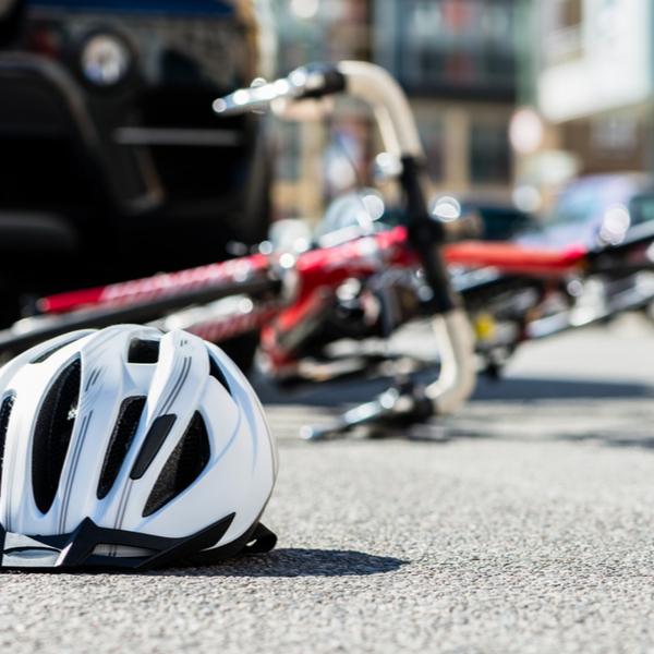 bicycling helmet fallen on asphalt